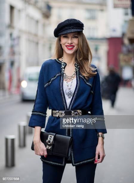Alexandra Lapp wearing dark blue cropped pants and blazer shaped cardigan from Airfield So Kate heels in patent black Christian Loubboutin white silk...
