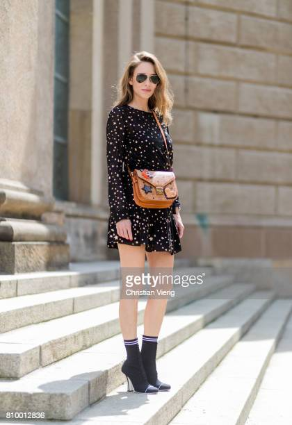 Alexandra Lapp wearing Fendis SS 17 collection sockboots with a grey knit upper with a high sculptural heel a black silk chiffon mini dress with...
