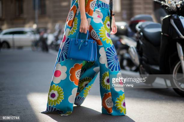 Alexandra Lapp wearing flower power silk jacquard pants in multicolor with a long leg by Talbot Runhof with matching long vest made of flower power...