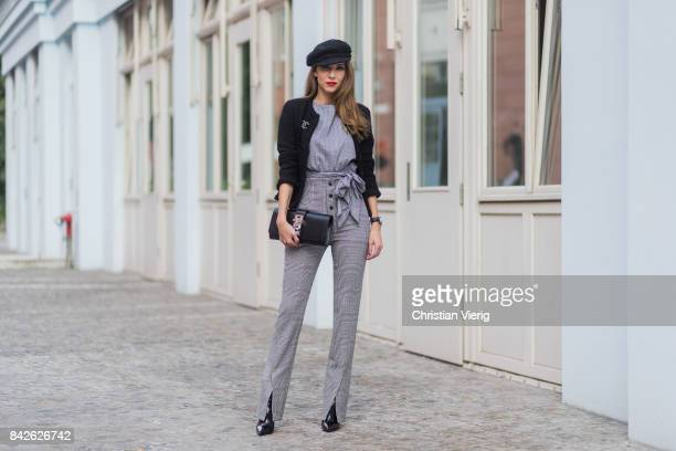 Alexandra Lapp wearing grey checked top and checked high waist pants by Zara flat cap hat from Chanel Tweed little black jacket in black from Chanel...