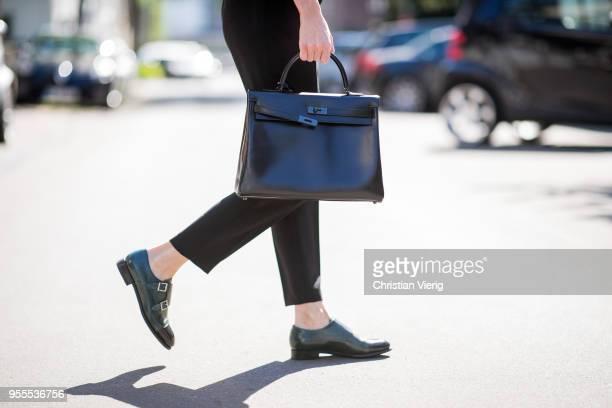 Alexandra Lapp wearing high waist black ankle cropped trousers by Zara, a blue Steffen Schraut denim shirt, a black vintage logo belt by Hermes, the...