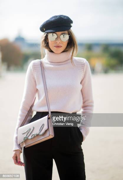 Alexandra Lapp wearing high waist pants in black from Zara cashmere turtleneck in light pink from Jil Sander light pink calf leather logo plaque...
