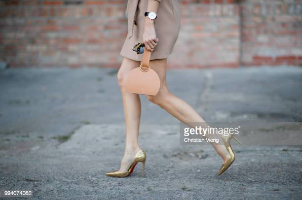 Alexandra Lapp wearing Jordyn Blazer Dress in mocha by Misha Collection bag Numero Six in camel by Polene Paris Iriza Glitter heels in gold by...