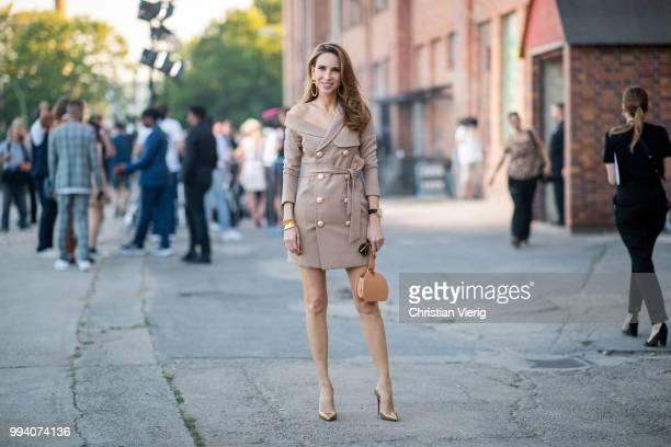 Alexandra Lapp wearing Jordyn Blazer Dress in mocha by Misha Collection bag Numero Six in camel by Polene Paris Iriza Glitter heels in gold by...