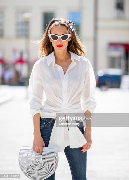 Alexandra Lapp wearing La Chemise Olhao in off white by Jacquemus blue AG Adriano Goldschmied denim white Inez leather sandals by Saint Laurent white...