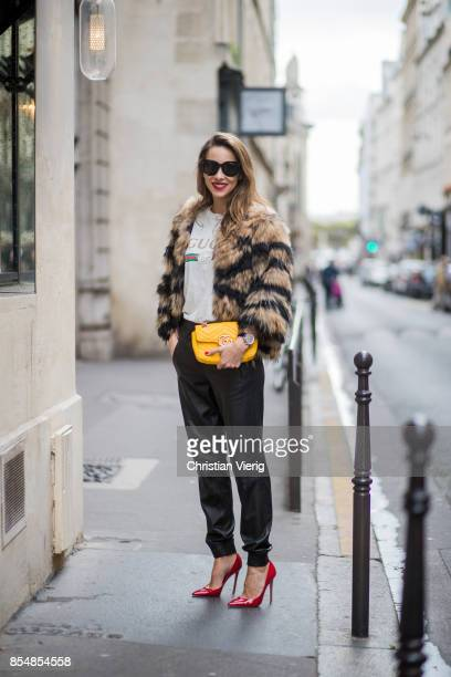 Alexandra Lapp wearing leather trackies in black from Set Fashion vintage style Gucci logo tee little fur jacket by Set yellow GG Marmont matelasse...
