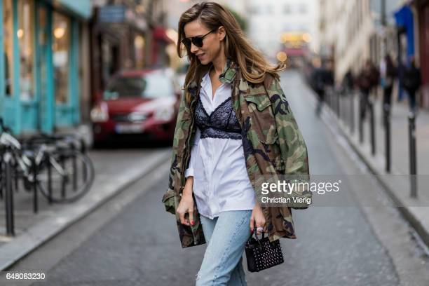 Alexandra Lapp wearing Light blue Levi's 501 Skinny Jeans with button fly in the classic fivepocket design signature Levi's tab and arch are stitches...