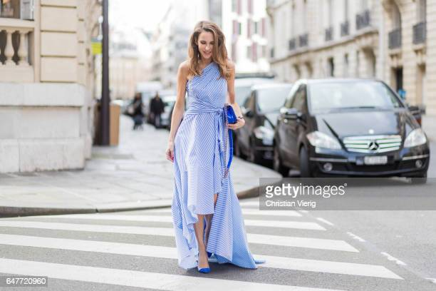 Alexandra Lapp wearing Long dress made of stripe stretch seersucker color greek blue and white from Talbot Runhof Blue pumps from Gianvito Rossi Blue...