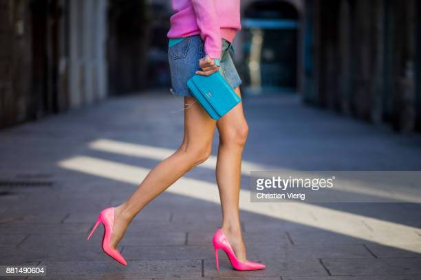 Alexandra Lapp wearing mini jeans skirt from Levis batik cashmere pullover from Heartbreaker in turquoise and pink Jadicted silk blouse in turquoise...