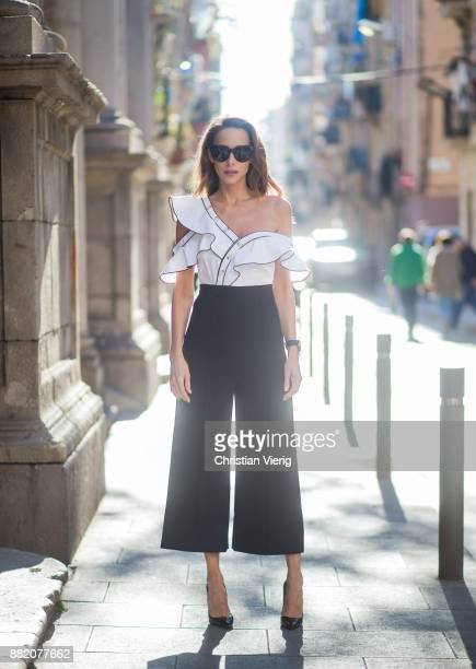 Alexandra Lapp wearing monochrome frill jumpsuit from SelfPortrait Celine Audrey sunglasses in black and Christian Louboutin Pigalle heels in black...