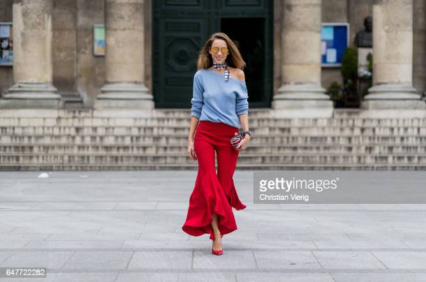 Alexandra Lapp wearing scarf Hermes Bruno Manetti Cashmere knitwear in light blue Flared trousers with asymmetric hem in carmen style in bright red...