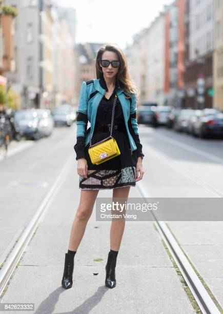 Alexandra Lapp wearing skirt black blouse cardigan Airfield Boy Bag in shining yellow from Chanel Ankle boots YSL Opyum boots Sunglasses Diormania...