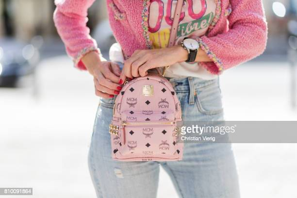Alexandra Lapp wearing Stark backpack in pink from MCM Visetosprint coated canvas including a dedicated sleeve for mobile devices a high waist...