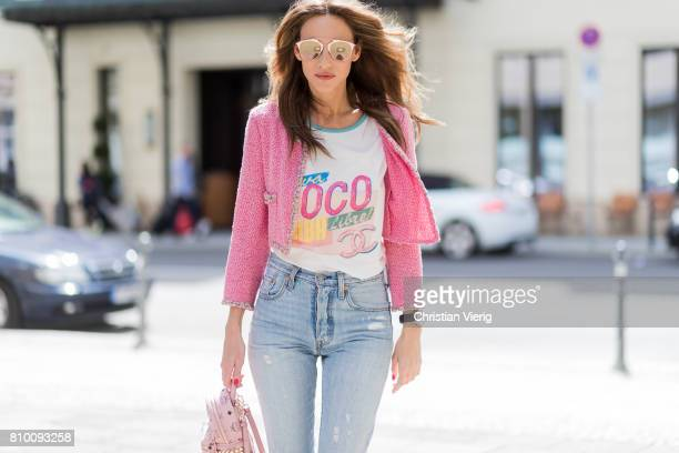 Alexandra Lapp wearing Stark backpack in pink from MCM Visetosprint coated canvas a high waist nonstrech denim and fivepocket 501 skinny jeans from...