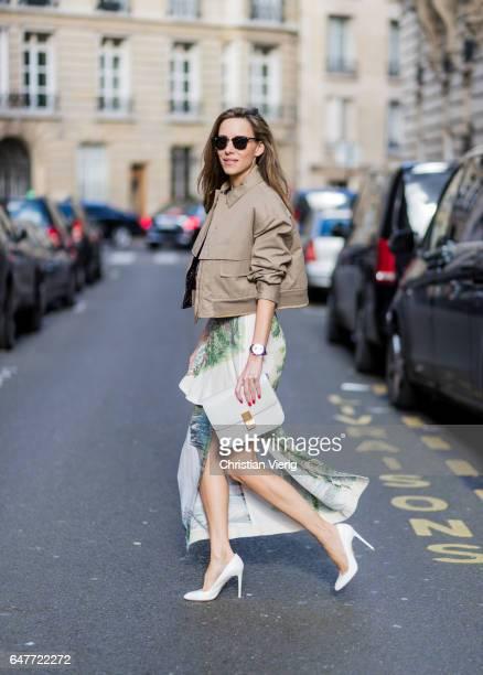 Alexandra Lapp wearing Stella McCartney long viscose cady skirt in cream landscape print Stella McCartney blouse / Aspen boxy style shirt in cream...