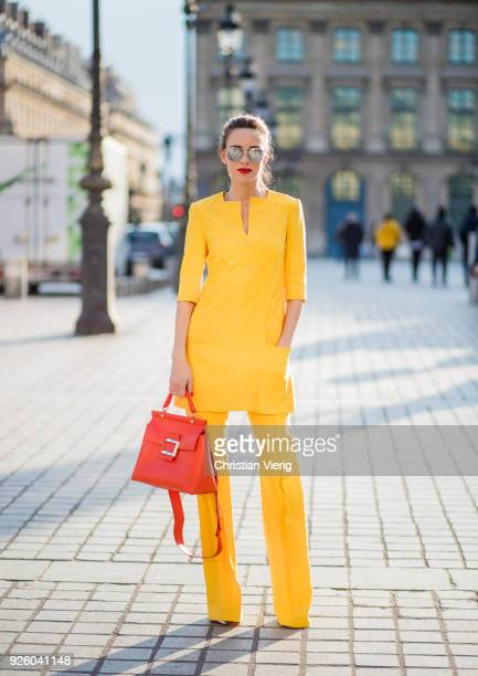 Alexandra Lapp wearing taroni silk pants a tunic in yellow from Talbot Runhof small Viv Cabas in orange with shoulder strap mirrored sunglasses from...
