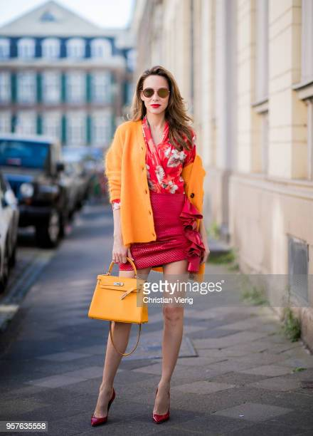 Alexandra Lapp wearing the Evangelista knitted cardigan by Ganni in turmeric orange Hawaiian multicolored silk kimono with allover print by Jadicted...