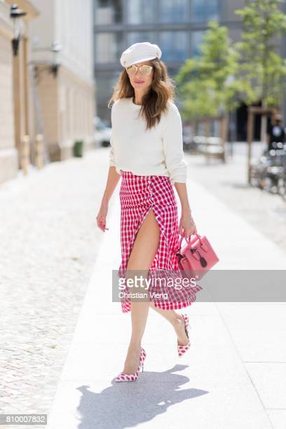 Alexandra Lapp wearing the Milla Tote bag from MCM which is crafted in Spanish leather white knitwear from Oui Fashion Chanel cap in white Dior...