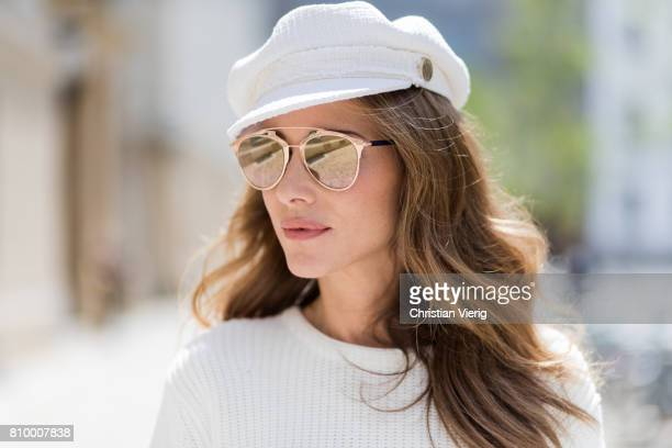 Alexandra Lapp wearing the Milla Tote bag from MCM which is crafted in Spanish leather, white knitwear from Oui Fashion, Chanel cap in white, Dior...
