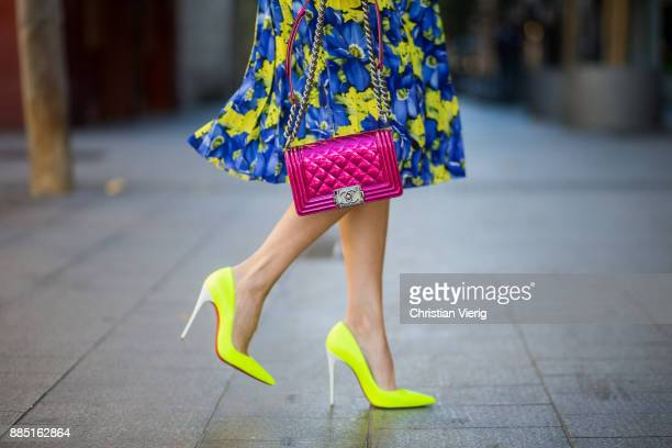 Alexandra Lapp wearing the yellow Alberta Ferretti Monday jumper pleated skirt with flower prints by Balenciaga a dark red quilted small boy bag by...