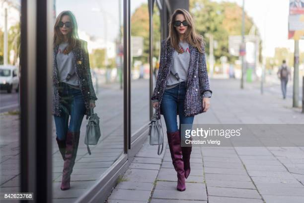 Alexandra Lapp wearing Vintage sweater from Chanel overknee boots in burgundy from Zara oversized long tweed jacket with pearls from Zara high waist...