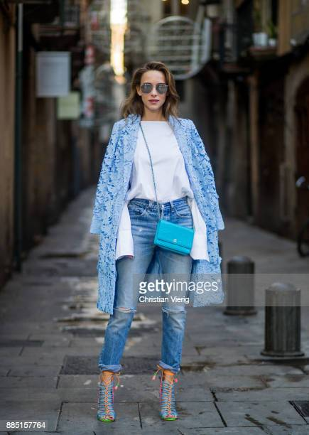 Alexandra Lapp wearing white off-shoulder blouse and light blue coat with flowers from Steffen Schraut, silver mirrored sunglasses from Le Specs,...