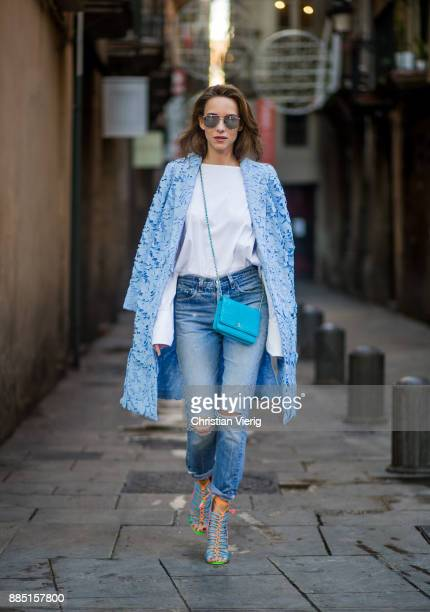 Alexandra Lapp wearing white offshoulder blouse and light blue coat with flowers from Steffen Schraut silver mirrored sunglasses from Le Specs...