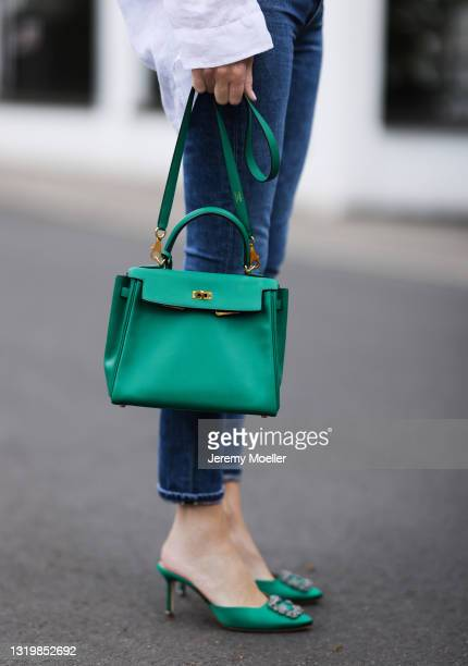 Alexandra Lapp wearing white Pancaldi & B for Tandem linen blouse, blue Citizens of Humanity jeans, green Hermès Kelly leather bag and green Manolo...