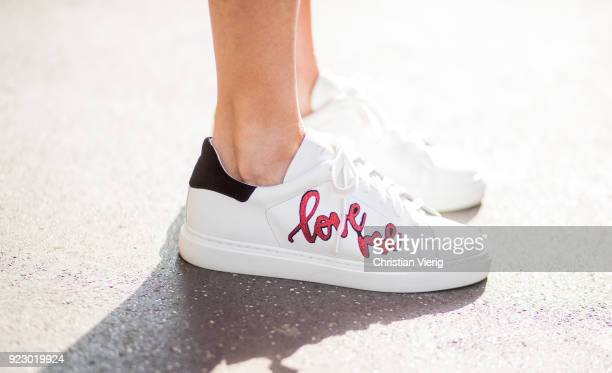 Alexandra Lapp wearing white sneakers with applications from Steffen Schraut seen during Milan Fashion Week Fall/Winter 2018/19 on February 21 2018...