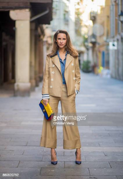 Alexandra Lapp wearing wide cut khaki pants from Steffen Schraut khaki jacket with blue collar and blue and white strips on the bottom of the sleeve...