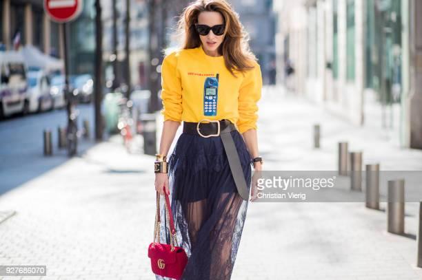 Alexandra Lapp wearing yellow Wodka Ogurez sweater with handmade Nokia phone print long dark blue SelfPortrait lace dress underneath Dorothee...