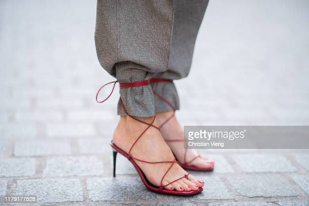 Alexandra Lapp wearing YSL Saint Laurent sandals in red worn over the pants during Paris Fashion Week Womenswear Spring Summer 2020 on September 23...