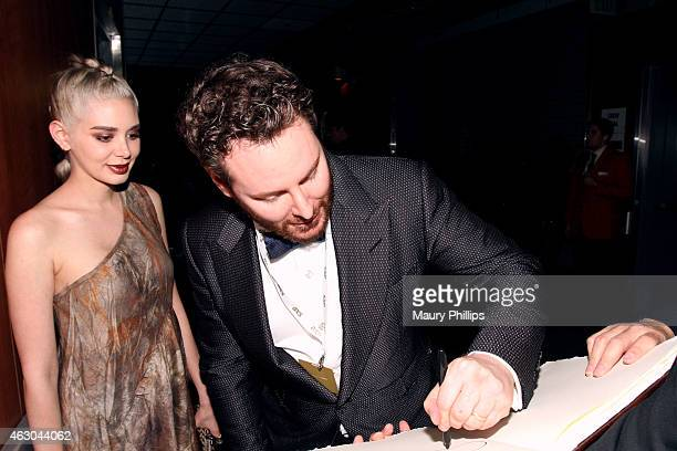 Alexandra Lenas and Sean Parker pose backstage at the GRAMMY Charities Signings during The 57th Annual GRAMMY Awards at the STAPLES Center on...