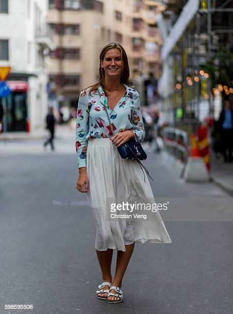 Alexandra Livijn wearing a baby blue blouse white maxi skirt and white Birkenstock sandals on September 1 2016 in Stockholm Sweden
