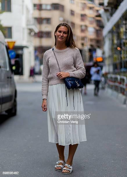 Alexandra Livijn wearing a jumper white maxi skirt and white Birkenstock sandals on September 1 2016 in Stockholm Sweden