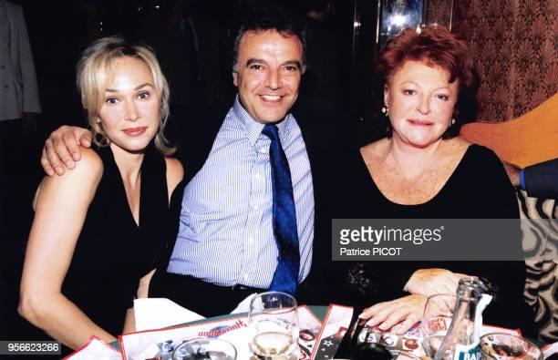 Alexandra Lorska Alain Afflelou et Régine lors d'une soirée à Paris dans les années 90 France Circa 1990