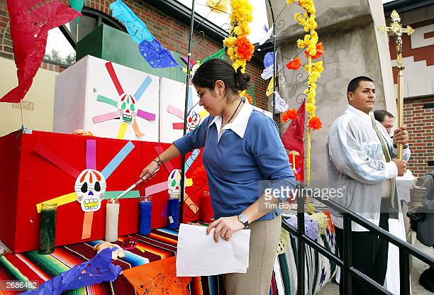 Alexandra Macias participates in the 'lighting the light of the dead' at the alter during the Dia de los Muertos celebration October 31 2003 at the...