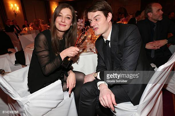 Alexandra Maria Lara and her husband Sam Riley and award during the PEOPLE Style Awards at Hotel Vier Jahreszeiten on March 7 2016 in Munich Germany