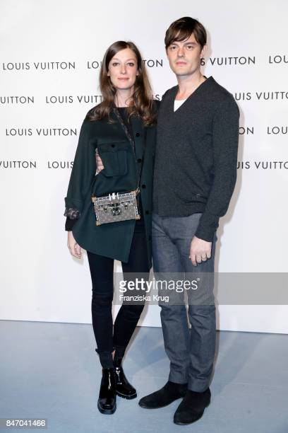 Alexandra Maria Lara and her husband Sam Riley wearing Louis Vuitton attend the 'Louis Vuitton Time Capsule' Exhibition Opening at Franzoesisches...