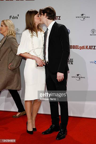 Alexandra Maria Lara kisses her husband Sam Riley at the 'RUBBELDIEKATZ' Premiere at Cinemaxx on November 30 2011 in Berlin Germany