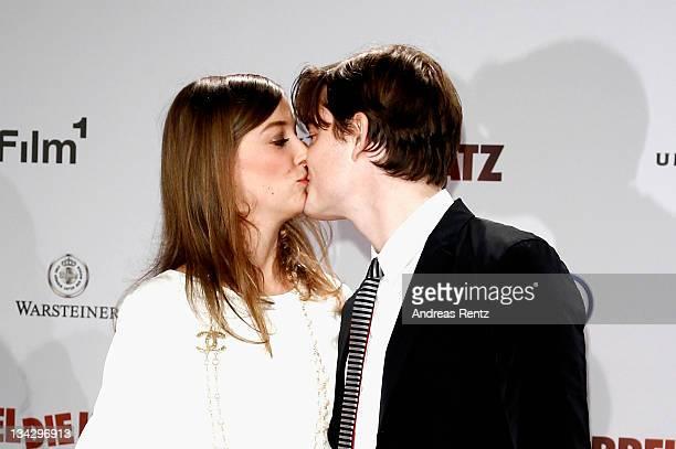 Alexandra Maria Lara kisses her husband Sam Riley at the RUBBELDIEKATZ Premiere at Cinemaxx on November 30 2011 in Berlin Germany