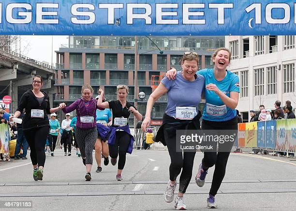 Alexandra McRobert and her mother Susan Humphrey cross the finish line of the Yonge Street 10k run at Fort York Blvd Sunday morning Toronto April 13...