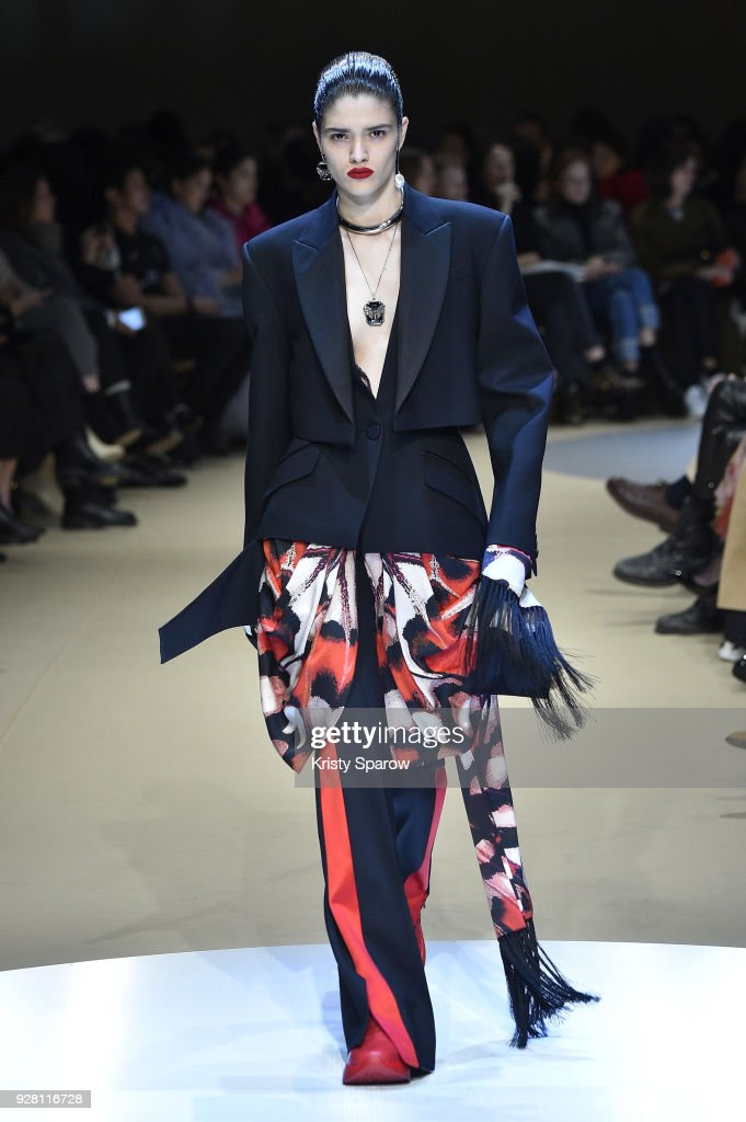Alexandra Micu walks the runway during the Alexander McQueen show as part of Paris Fashion Week Womenswear Fall/Winter 2018/2019 on March 5, 2018 in Paris, France.