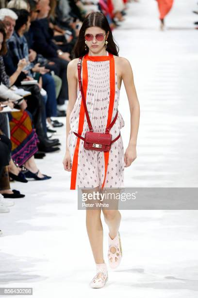 Alexandra Micu walks the runway during the Valentino show as part of the Paris Fashion Week Womenswear Spring/Summer 2018 on October 1 2017 in Paris...