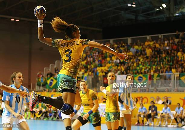 Alexandra Nascimento of Brazil scores against Argentina during the Women's Handball Final at the Pan Am Games on July 24 2015 in Toronto Canada