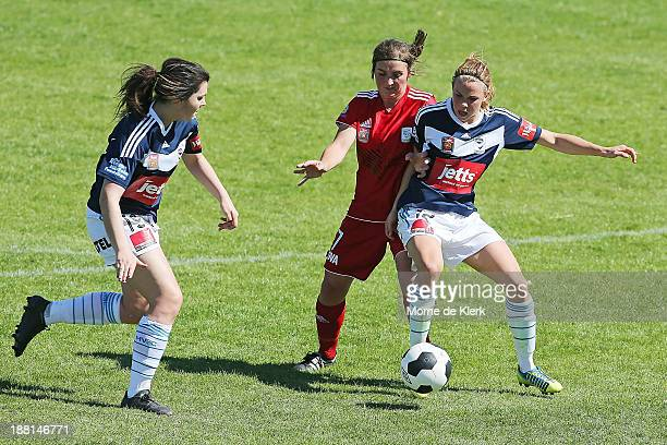 Alexandra Natoli and Jessica Samuelsson of the Victory keeps Rachael Quigley of Adelaide away from the ball during the round two WLeague match...