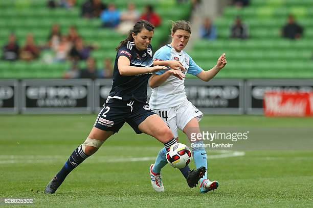 Alexandra Natoli of Melbourne Victory and Melina Ayres of Melbourne City compete for the ball during the round four ALeague match between Melbourne...