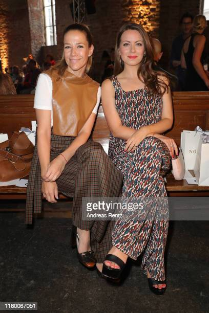 Alexandra Neldel and Alice Dwyer attend the Nobi Talai fashion show during the Berlin Fashion Week Spring/Summer 2020 at Parochialkirche on July 04...