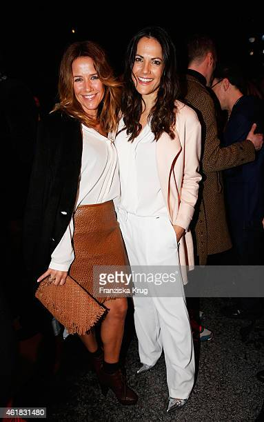 Alexandra Neldel and Bettina Zimmermann attend the Marc Cain show during the MercedesBenz Fashion Week Berlin Autumn/Winter 2015/16 at Brandenburg...