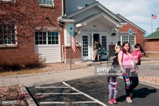 Alexandra Olivares and her children leave Inner City Health Center in Denver Colorado after a dental visit on March 15 2017 Inner City Health Center...